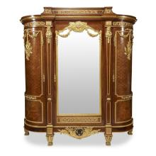 A fine and impressive Louis XVI style ormolu and enameled bronze mounted fruitwood marquetry and parquetry mahogany armoire, the mou...