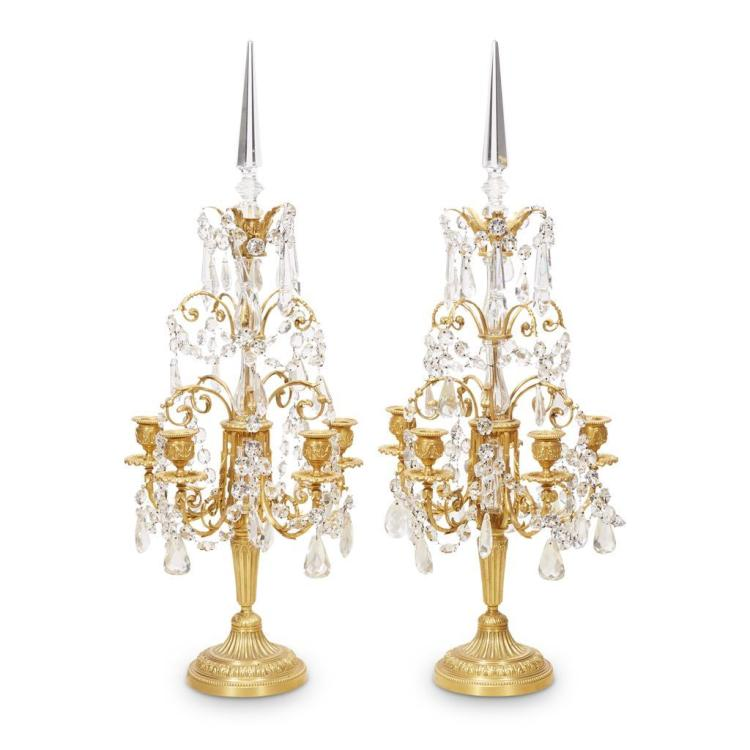 A pair of Louis XVI style giltmetal and cut crystal five-light girandoles, 20th century