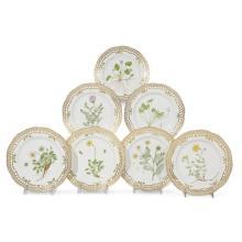 Seven Royal Copenhagen 'Flora Danica' reticulated luncheon plates, various dates 20th century