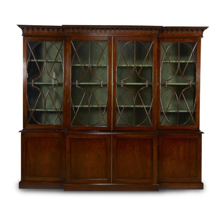 A George III style mahogany breakfront bookcase, incorporating 19th century elements