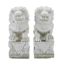 A pair of Chinese carved marble foo lions, possibly 19th century