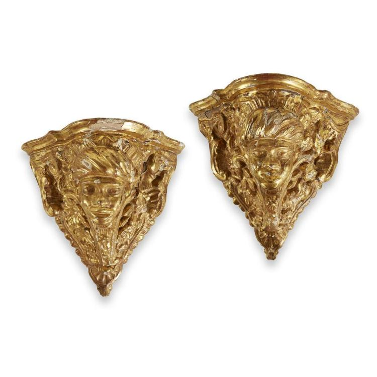 A pair of Continental giltwood blackamoor corner brackets in the Régence taste, 19th century