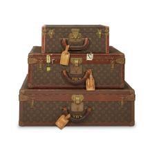 Three graduated Louis Vuitton monogrammed canvas hard-sided suitcases, mid 20th century