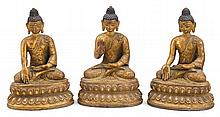 Set of three Tibetan bronze buddhas, 19th century, Each figure with hands in one of three mudras abhaya, bhumisparsa, and varada. All a
