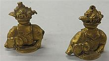 Pair of Chinese gilt bronze 'elephant' hat finials, , Each carved as an elephant supporting a jardinere of treasures on their back
