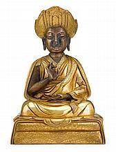 Sino-Tibetan gilt bronze figure of a lama, qing dynasty, The well-cast figure shown seated on a cushion in loose robes and adorned flat