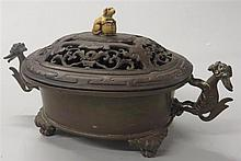Chinese bronze censer, , Oblong form with two qiling as handles, raised on four cabriole legs and with pierced wood cover surmounted by