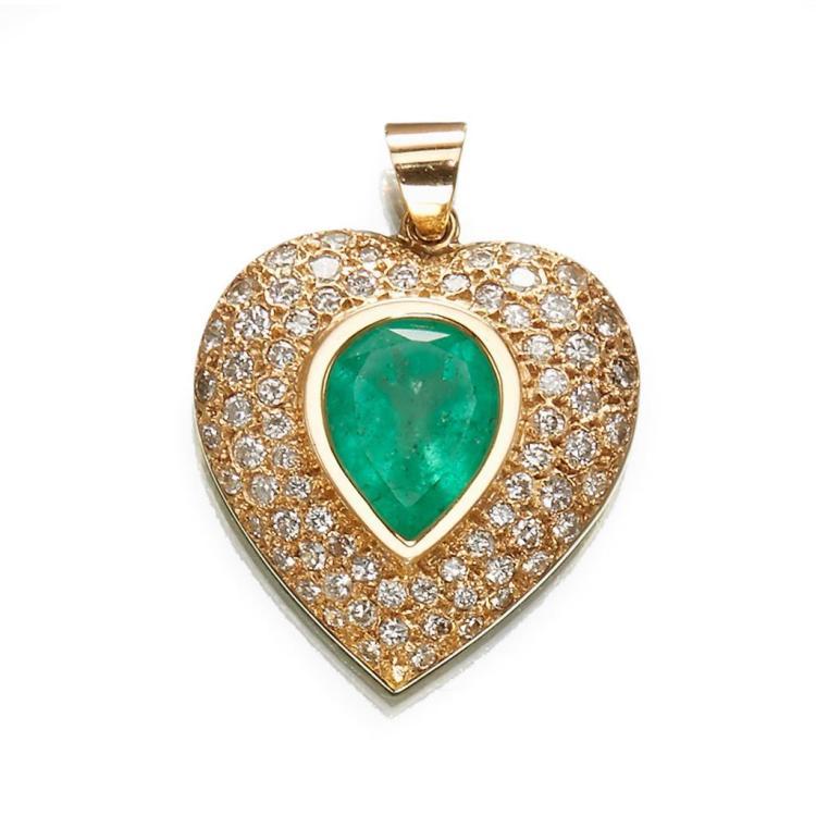 An emerald, diamond and fourteen karat gold pendant,