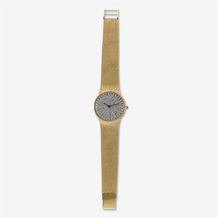 A fourteen karat gold and diamond bracelet watch,