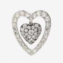 A diamond and fourteen karat white gold brooch,
