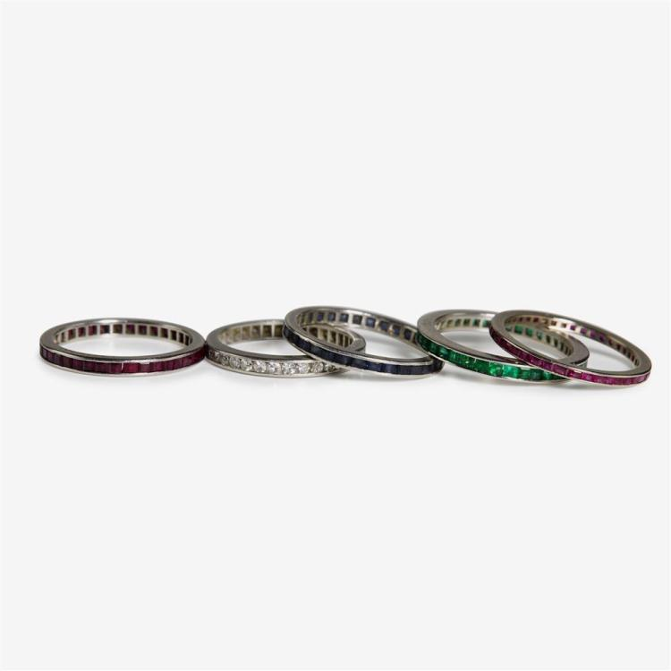 A collection of five gemstone rings,
