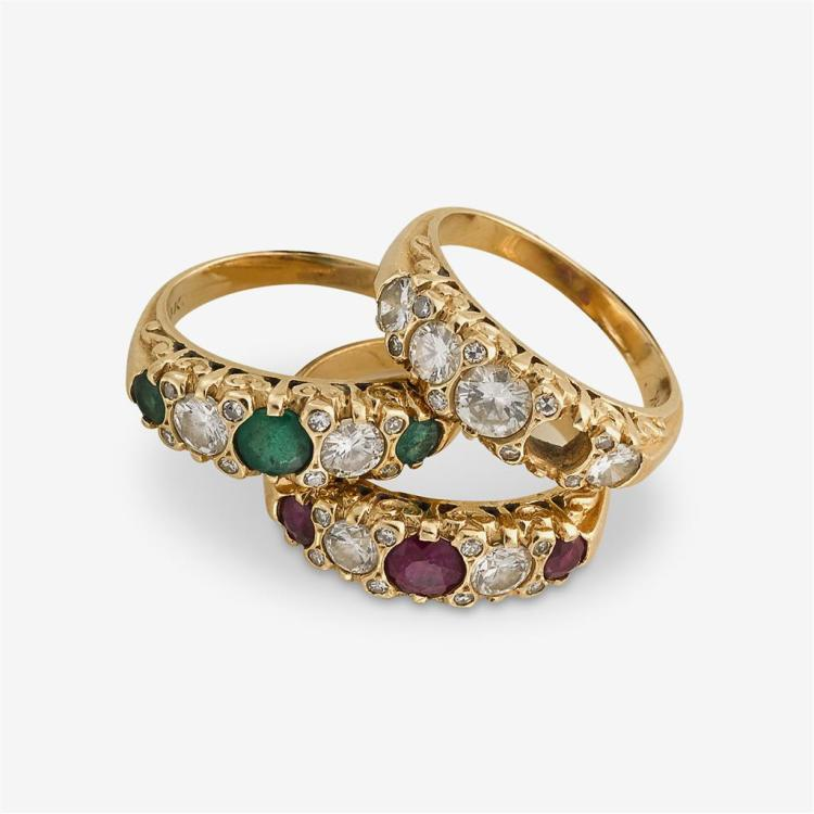 A collection of three gem-set and fourteen karat gold rings,