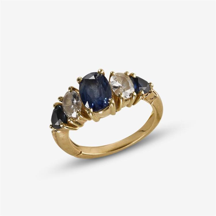 A sapphire, diamond and fourteen karat gold ring,