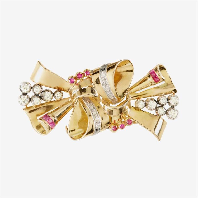 A retro diamond, ruby and eighteen karat gold brooch,