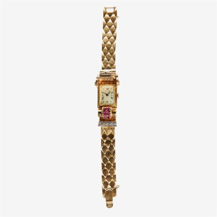 A Retro diamond, ruby and fourteen karat gold covered dial bracelet watch,