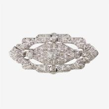 A diamond, silver and fourteen karat white gold mounted brooch,