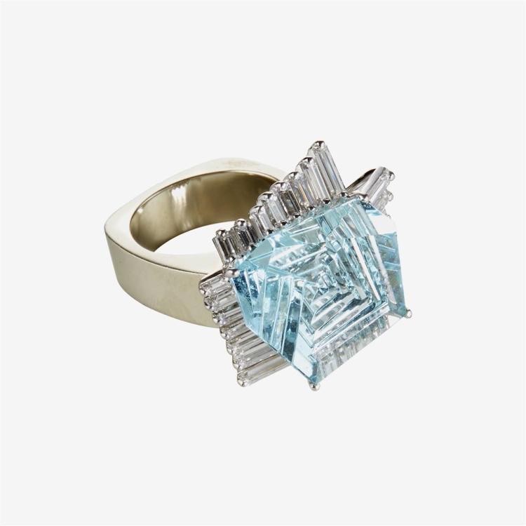 A topaz, diamond and fourteen karat white gold ring,