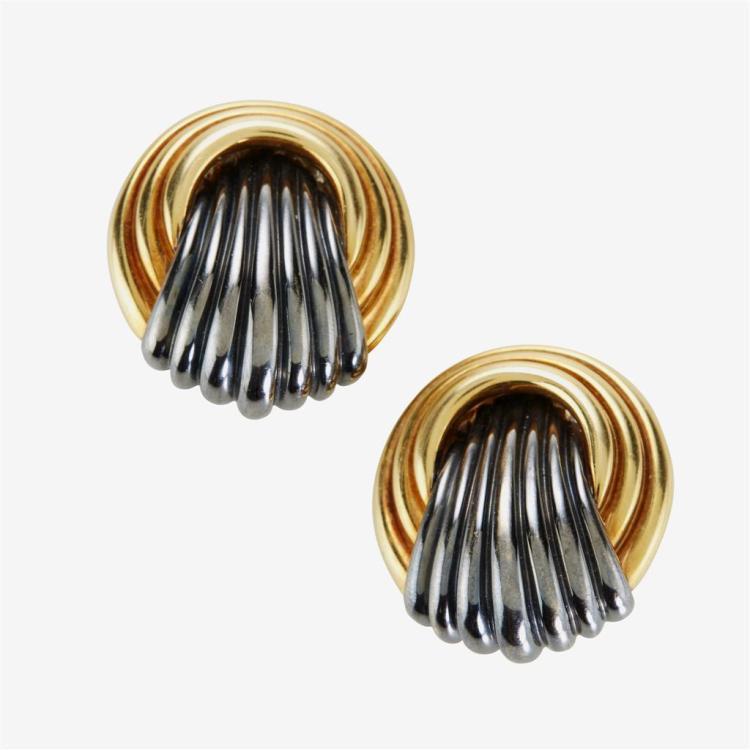 A pair of black rhodium and eighteen karat gold ear-clips,