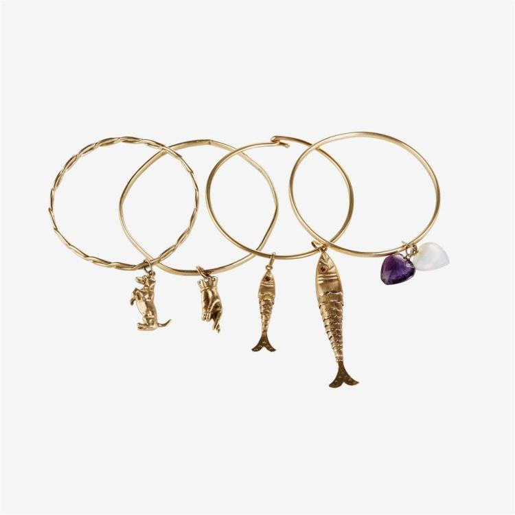 A collection of four fourteen karat gold bangles with gemstone and fourteen karat gold charms,