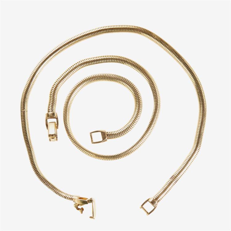 A pair of fourteen karat gold chains,