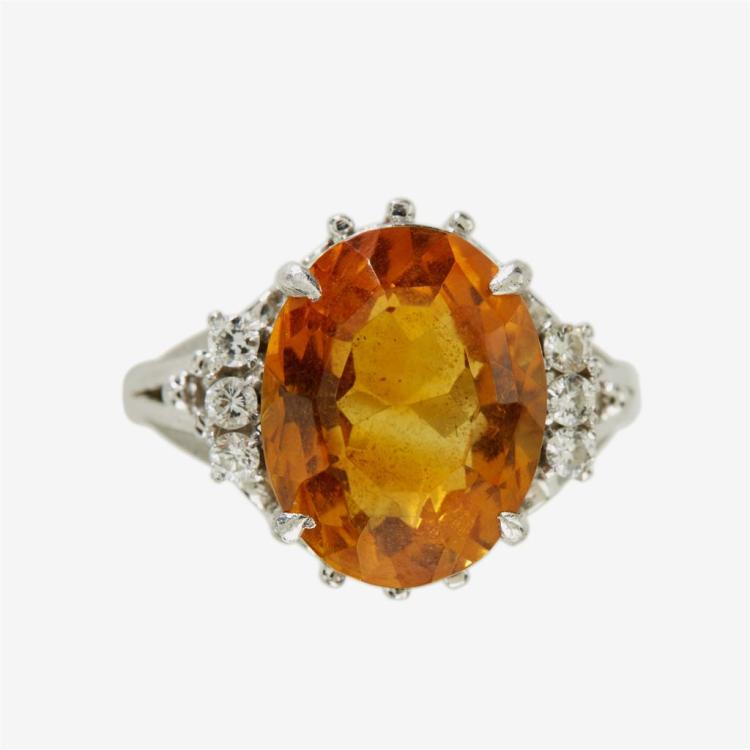 A citrine and diamond platinum ring,