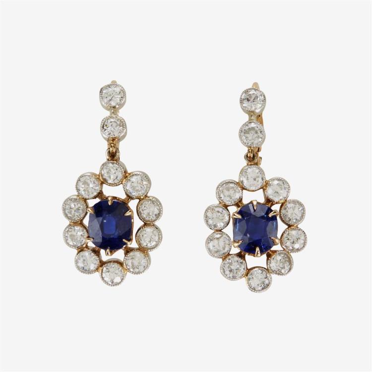 A pair of sapphire, diamond and fourteen karat gold earrings, circa 1920''s