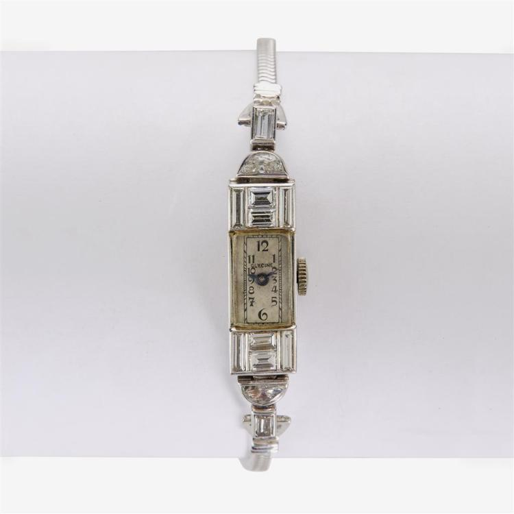 A diamond and platinum watch with later added fourteen karat white gold bracelet, Glycine,