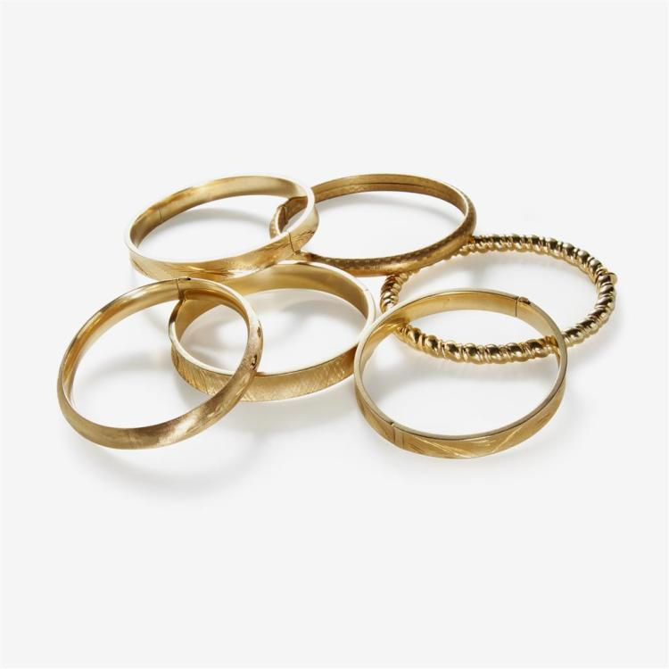 A collection of six gold bangles,