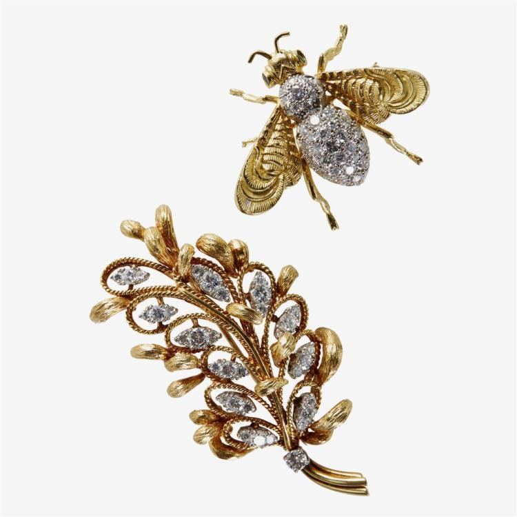 A collection of two diamond, synthetic gemstone and eighteen karat gold brooches,