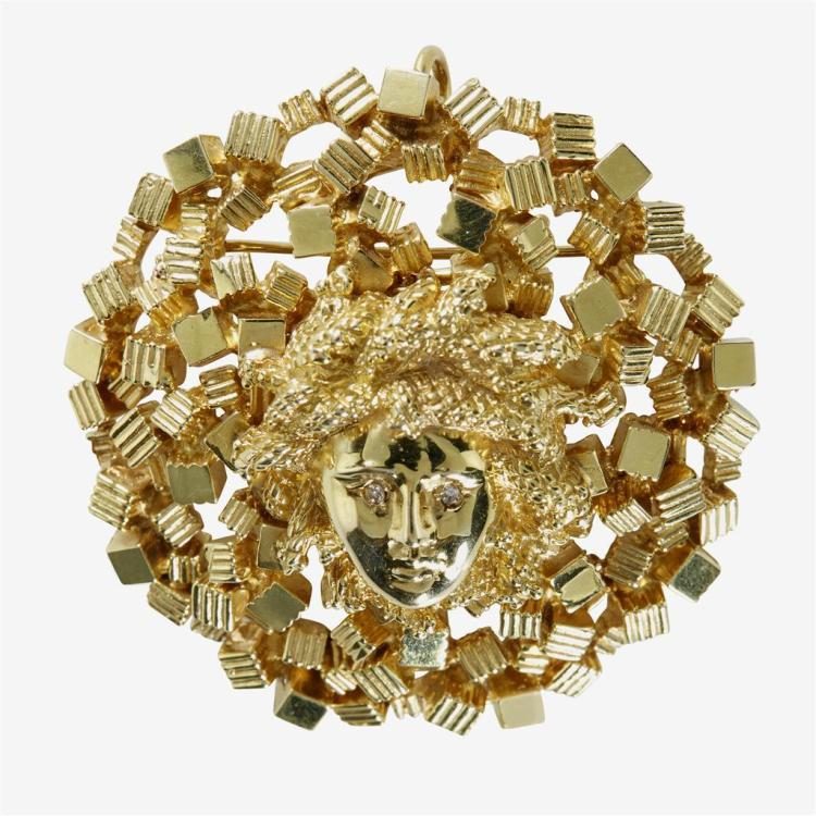 A fourteen karat gold brooch,