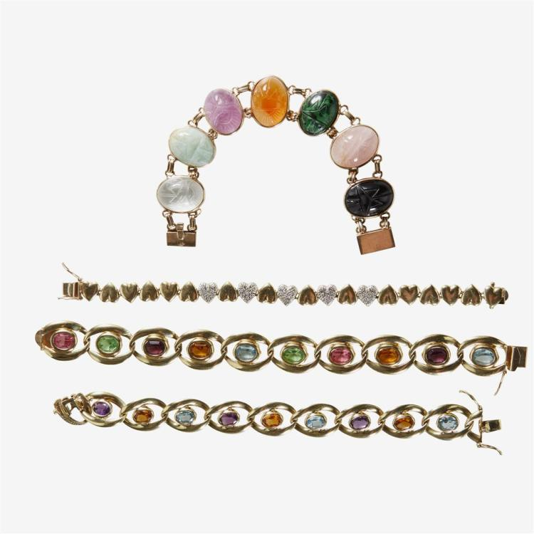A collection of gemstone, diamond and fourteen karat gold bracelets,