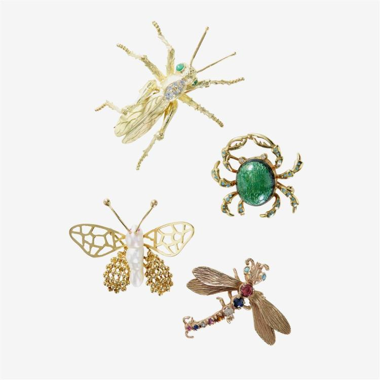 A collection of four gem-set and gold brooches,