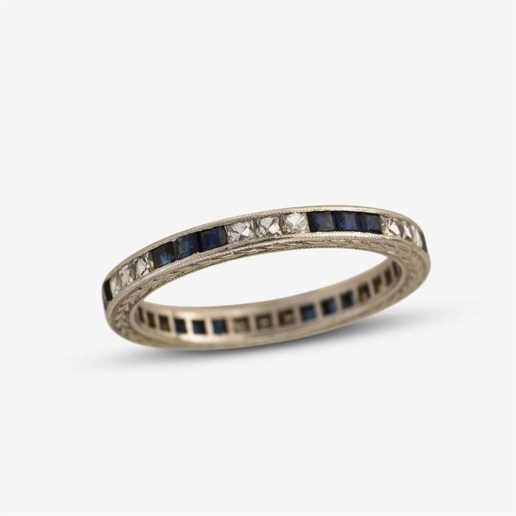A diamond and sapphire platinum band,