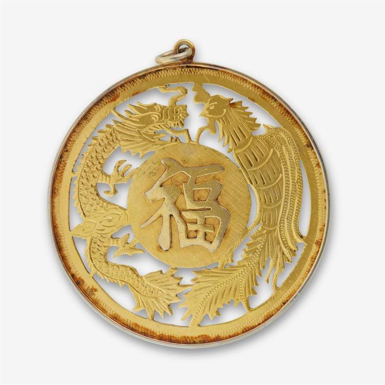 A fourteen karat gold pendant,