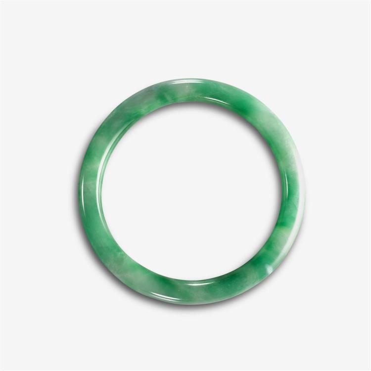 A treated jadeite jade bangle,