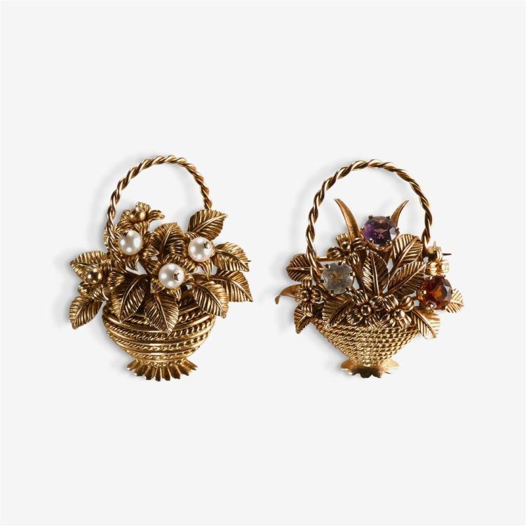 A pair of gem-set and eighteen karat gold brooches,