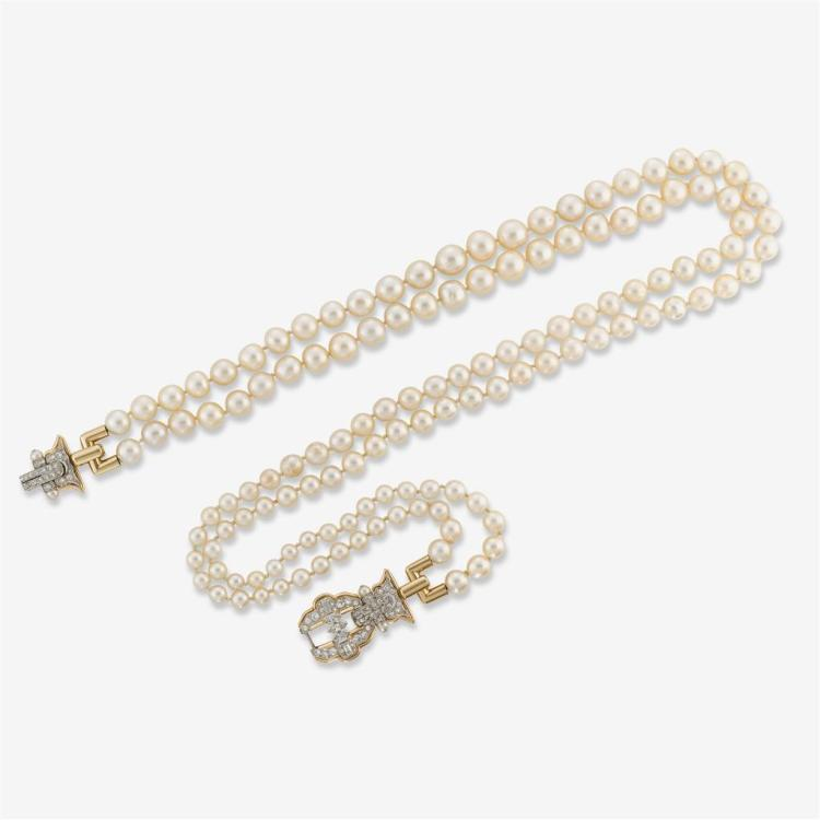 A cultured pearl, diamond and fourteen karat gold double strand necklace,