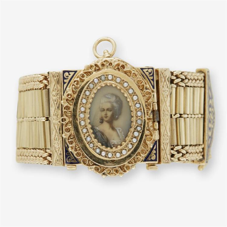 A fourteen karat yellow gold tassel watch,