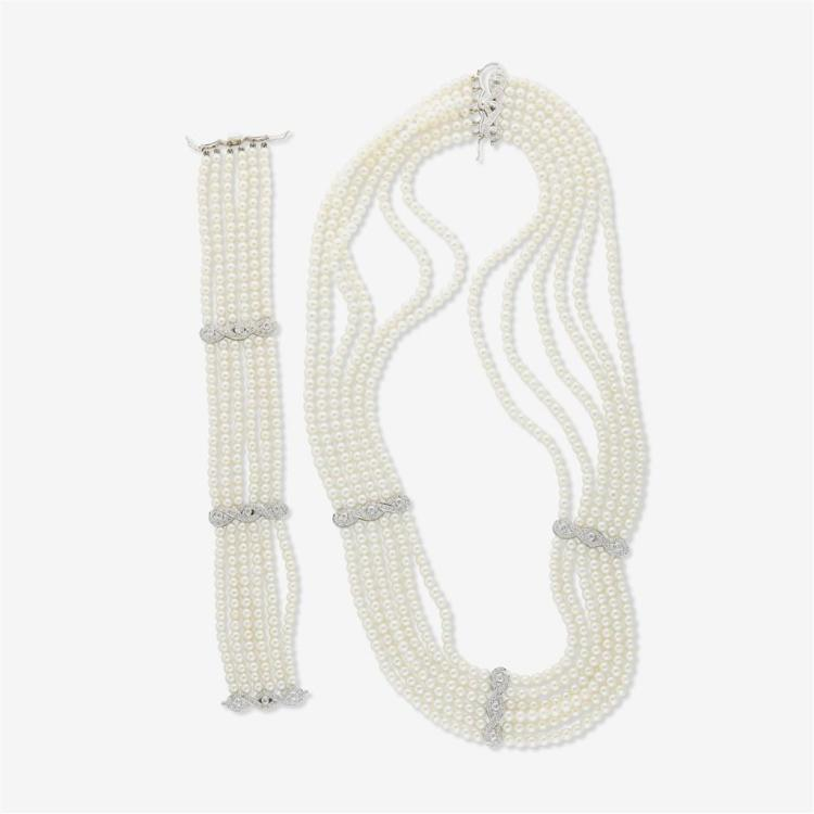 A cultured pearl and eighteen karat white gold diamond necklace and bracelet,