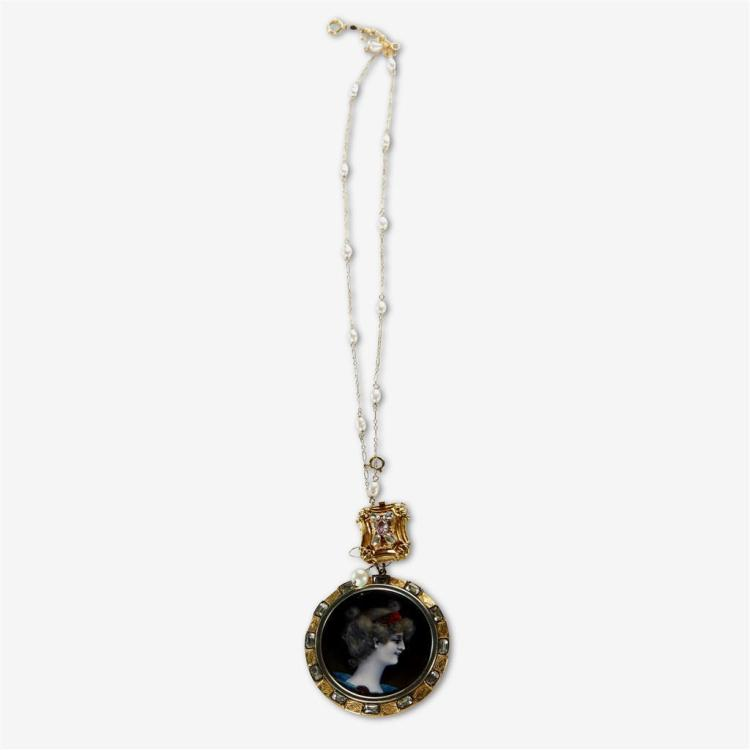 A metal and gold pendant necklace,