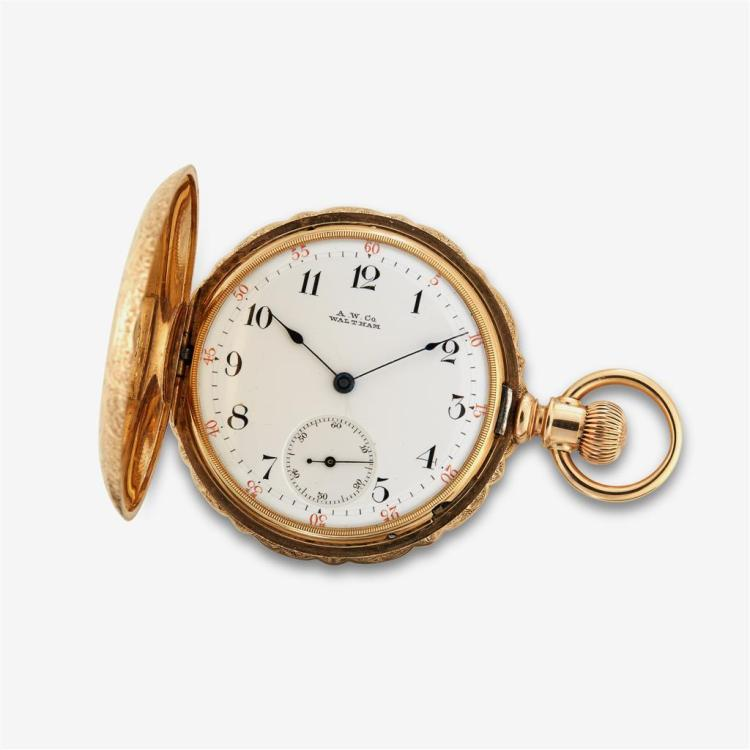 A fourteen karat gold hunting cased pocket watch, Waltham, riverside