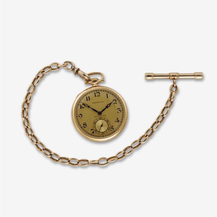 An eighteen karat gold pocket watch, Tiffany & Co. with later added fourteen karat gold chain.,