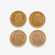 A collection of four South Africa Krugerrands,