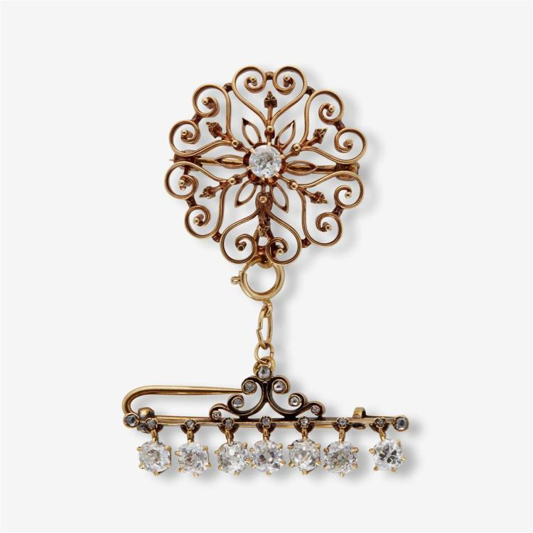 A collection of two diamond and gold brooches and one chain,