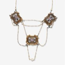 A gemstone, gold and metal necklace,