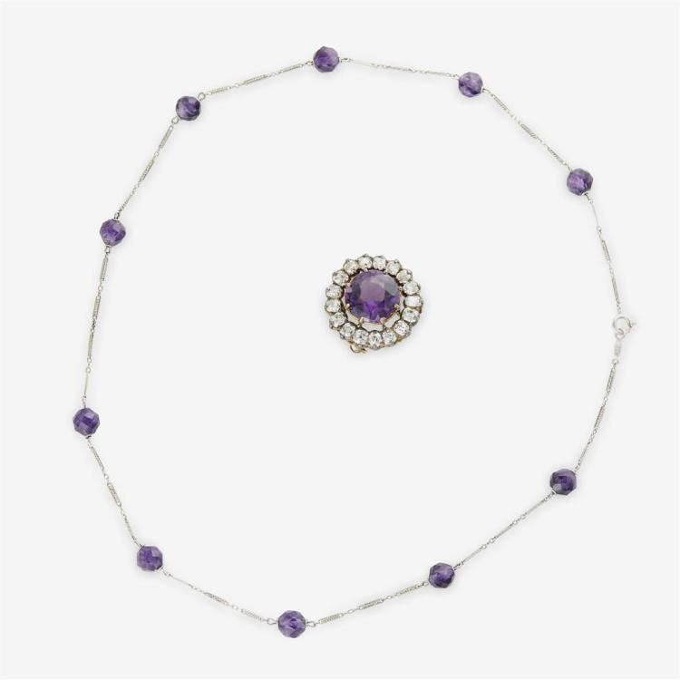 An antique amethyst and diamond brooch and faceted amethyst chain,
