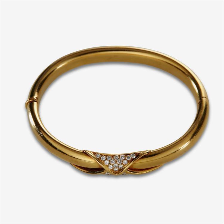 A diamond and eighteen karat gold bangle,