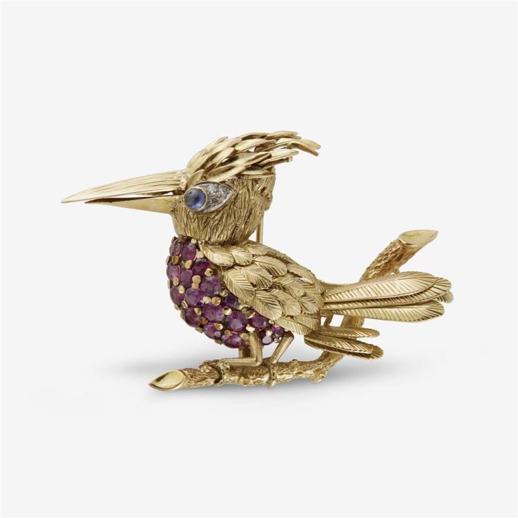 A ruby, sapphire and fourteen karat gold brooch,