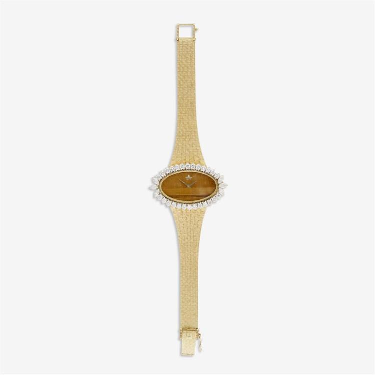 A diamond, eighteen karat gold and tiger''s eye bracelet watch, Universal Geneve,