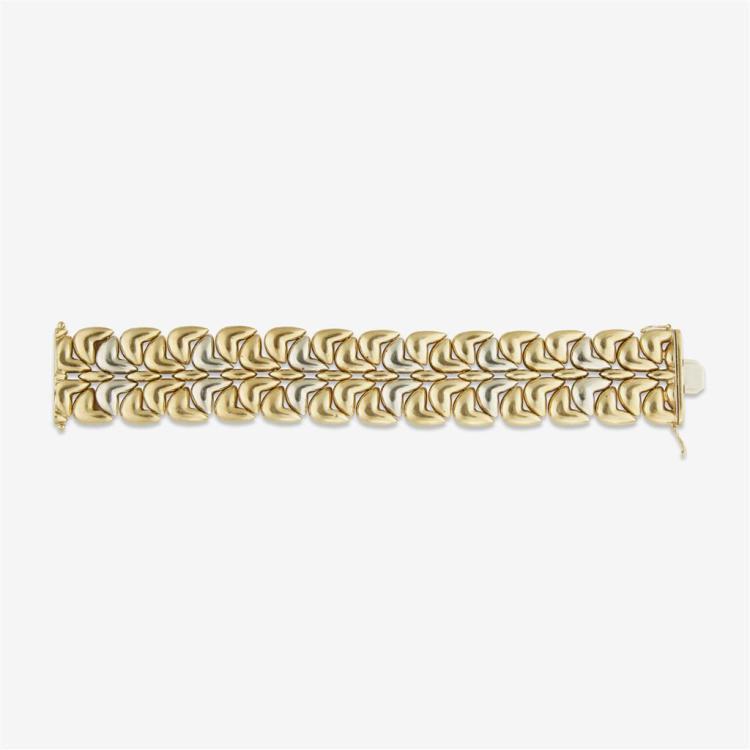 An eighteen karat two-tone gold bracelet,
